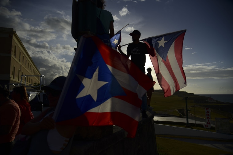 Demonstrators hold Puerto Rican flags as they protest against Gov. Ricardo Rosselló in San Juan in July 2019.
