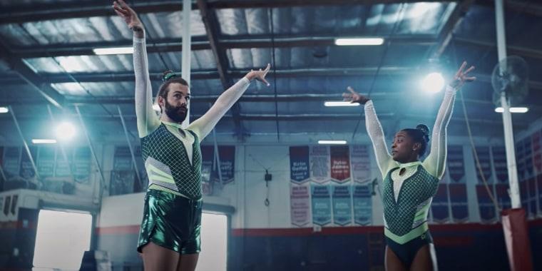 Jonathan Van Ness and Simone Biles in an ad for Uber Eats.