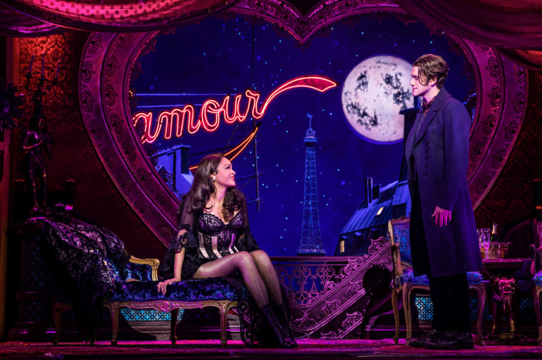 """Karen Olivo as Satine and Aaron Tveit as Christian in """"Moulin Rouge! The Musical"""" on Broadway."""