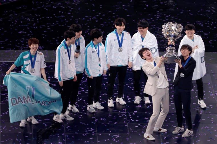 Image: Team DWG celebrates onstage after winning LoL World Championship Finals in Shanghai