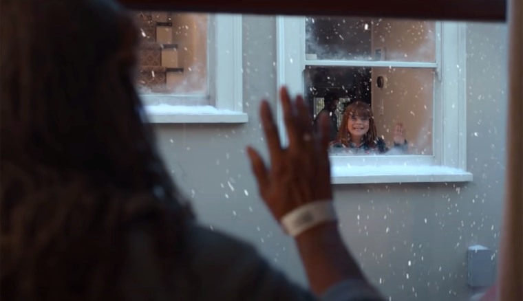 When the older woman appears in her window again, she's seen wearing a hospital bracelet.