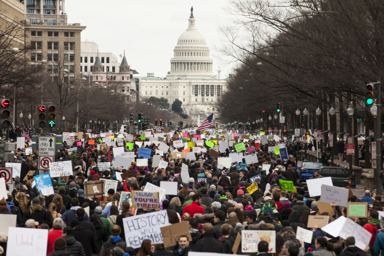 Image: Demonstrators march down Pennsylvania Avenue during a protest