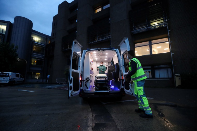 Image: Medical personnel prepare to leave for another mission outside of the CHU Dinant-Godinne hospital, amid the coronavirus disease (COVID-19) outbreak, in Mont-Godinne, Belgium