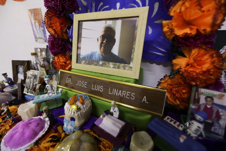 Image: A portrait of Dr. Jose Luis Linares who died from symptoms related to COVID-19, placed on a Day of the Dead altar made by his wife Rosario Martinez at their home in Mexico City,