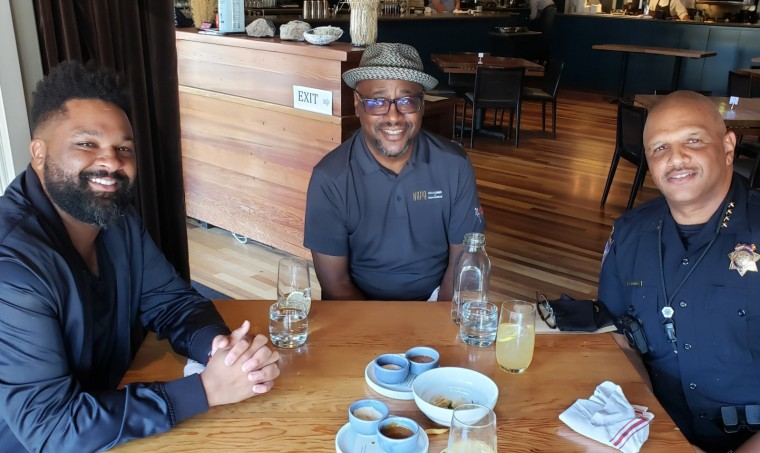 Napa Chamber of Commerce president and CEO Travis Stanley, center, enjoys lunch with two other Black influencers of Napa: master sommelier DLynn Proctor and police chief Robert Plummer.