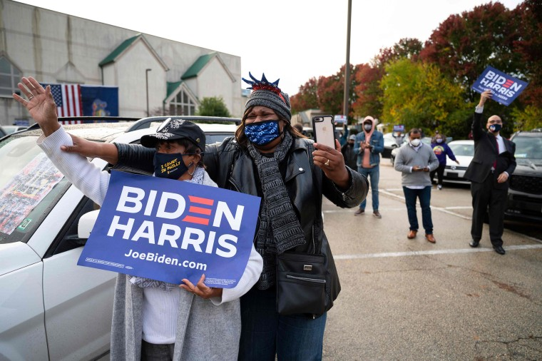 """Supporters cheer as Joe Biden speaks during a \""""Souls to the Polls\"""" event at Sharon Baptist Church in Philadelphia on Nov. 1, 2020."""