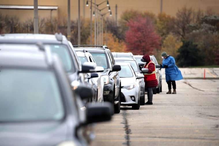 Image: Cars Line Up For Covid Testing In Milwaukee, As Cases Spike In The State