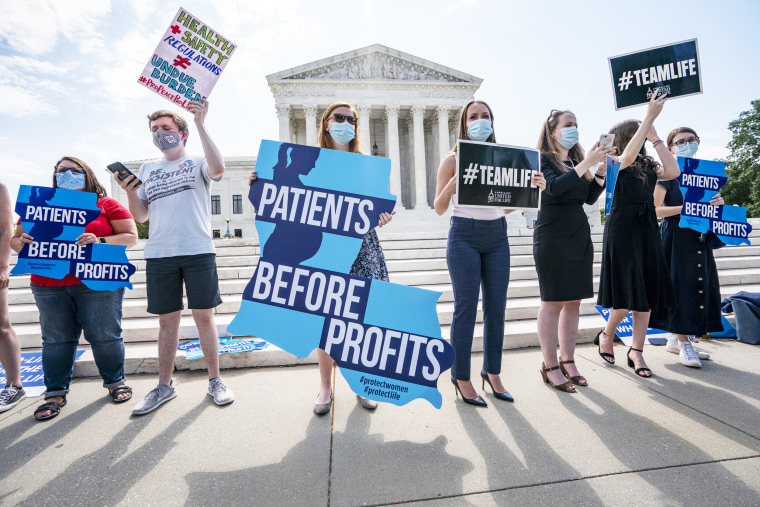 Anti-abortion-rights activists wait outside the Supreme Court for a decision in the Louisiana case Russo v. June Medical Services LLC in Washington on June 25.