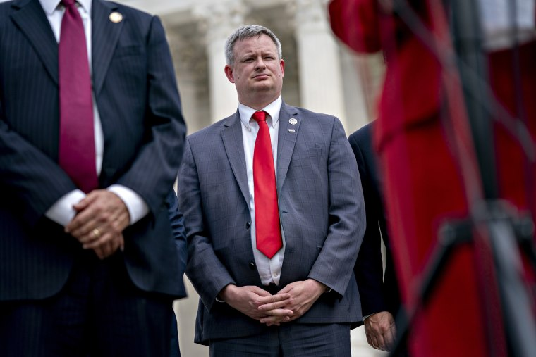 Image: Jason Ravnsborg, South Dakota attorney general, listens during a news conference outside the Supreme Court in Washington.