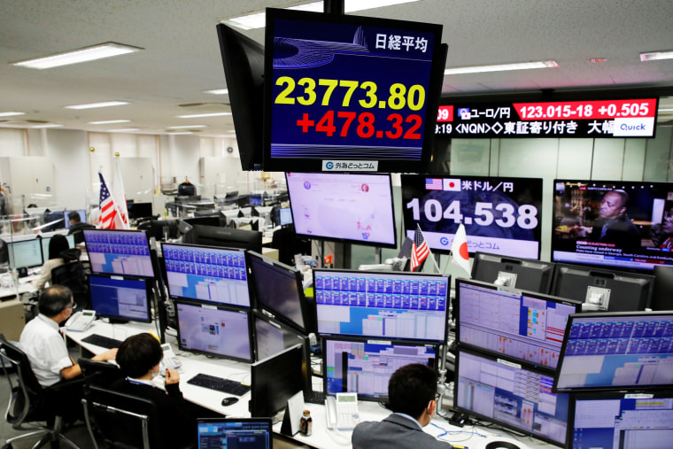 Image: A monitor shows Nikkei stock index at a foreign exchange trading company in Tokyo
