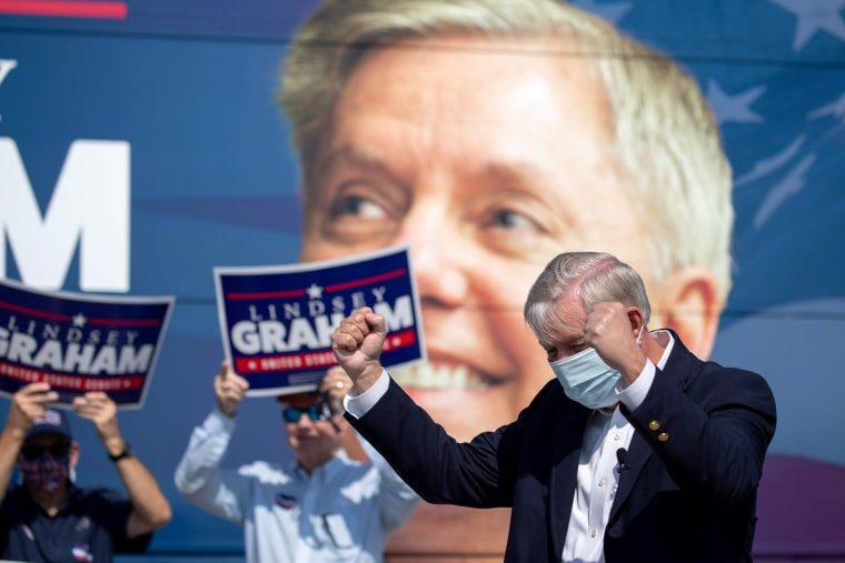 Image: Image: Sen. Lindsey Graham greets supporters in North Charleston, S.C., on Oct. 16, 2020.