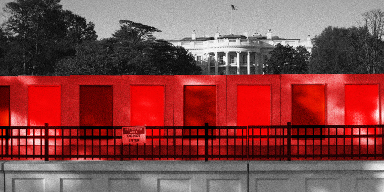 Image: The concrete fence outside the white house has a red overlay