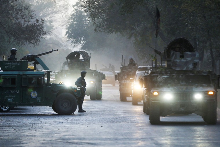 Image: Afghan security forces leave the site of an incident after an attack at the university of Kabul