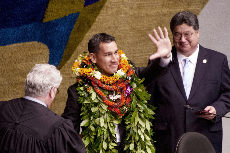 State Sen. Kai Kahele, center, waves at the Hawaii State Capitol in Honolulu on Feb. 17, 2016. Kahele was elected to the U.S. House to represent Hawaii's 2nd congressional district.