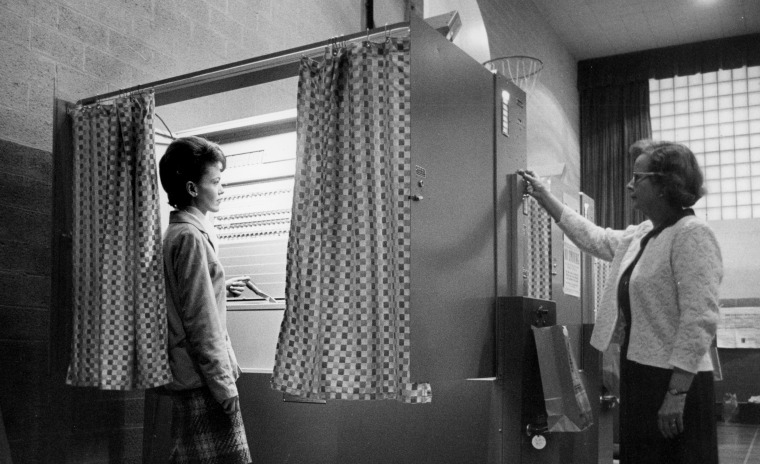 Image: A precinct official clears an automatic voting machine in Jamestown, N.Y., in 1965.