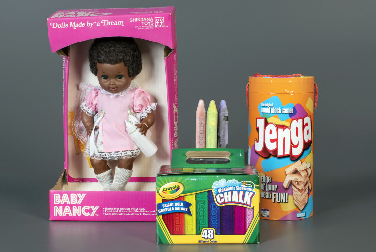 Image: Baby Nancy, by Shindana Toys; Sidewalk Chalk, by Crayola; and Jenga, by Parker Brothers, left to right, that were inducted into the National Toy Hall of Fame