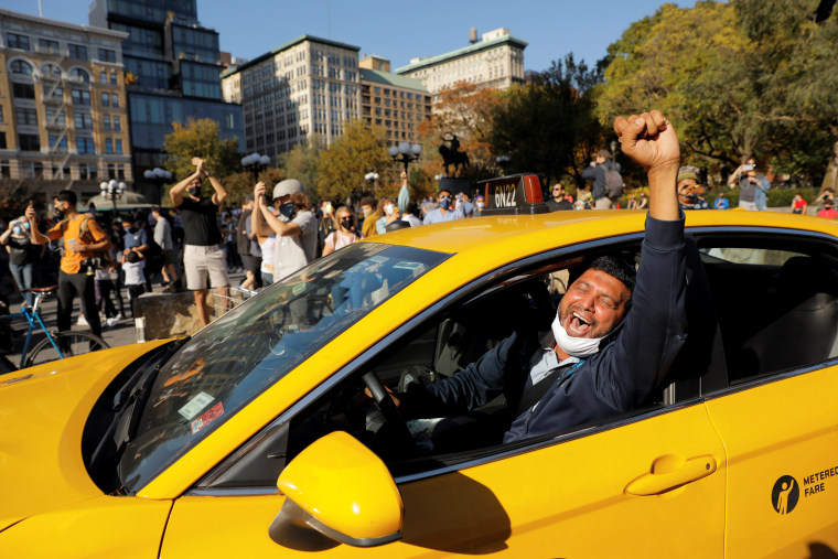 Image: People celebrate media announcing that Democratic U.S. presidential nominee Joe Biden has won the 2020 U.S. presidential election on Union Square in the Manhattan borough of New York City