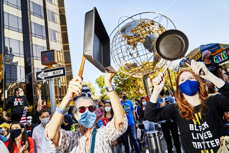 Image:New Yorkers bang pans as they celebrate in Columbus Circle.