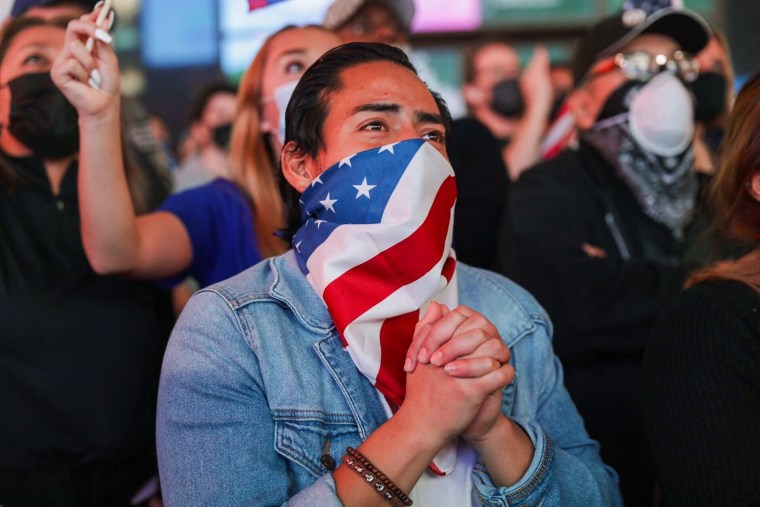 Supporters of president-elect Joe Biden watch his televised victory speech in Times Square.