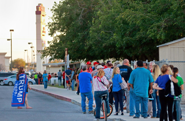 Image: Voters wait in a line to vote outside of Bob Ruud Community Center on Election Day on Nov. 3, 2020, in Pahrump, Nev.