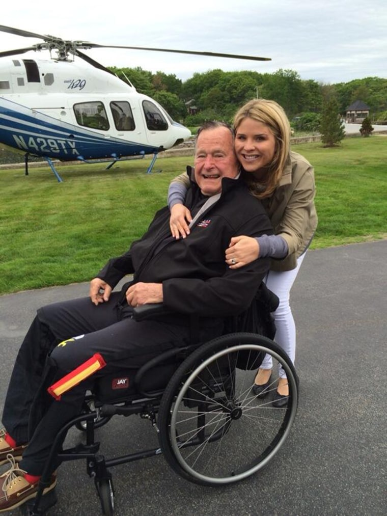 Jenna poses with her grandfather in 2014 before the former president went skydiving to celebrate his 90th birthday.