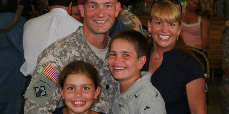 Lt. Col. Paul Huszar reunites with his family after returning from his deployment to Iraq.
