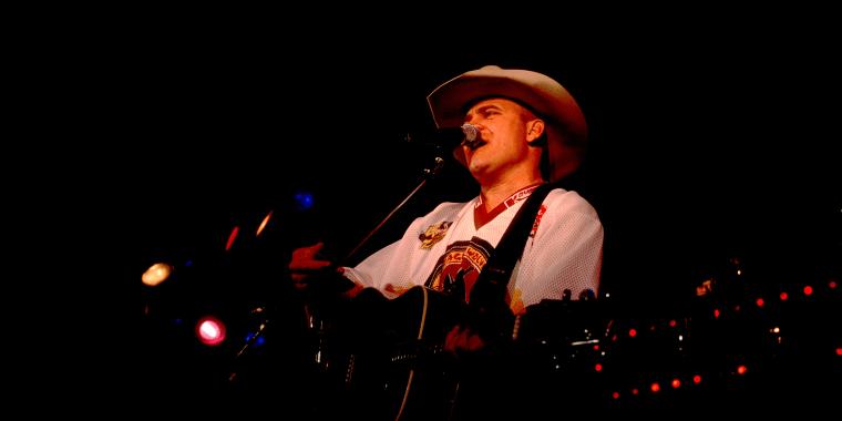 Doug Supernaw Performs On Stage