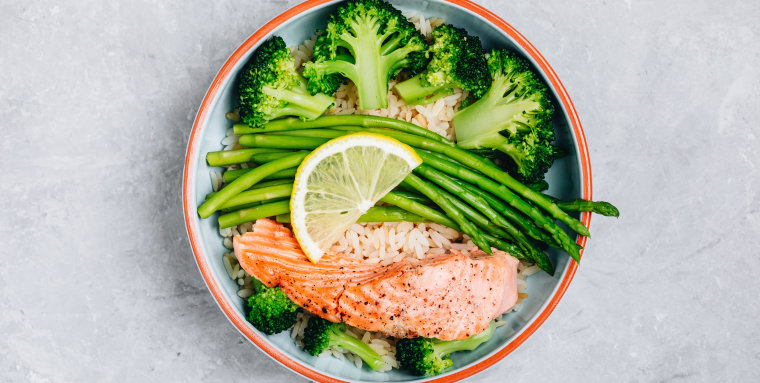 Healthy lunch bowl salmon and broccoli with asparagus and rice