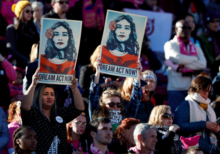 Image: Supporters of Deferred Action for Childhood Arrivals (DACA) hold signs during the Women's March rally in Las Vegas