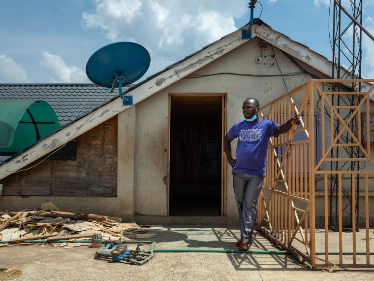 Image: Former Uber driver Harrison Munala on the rooftop of his former apartment building, where his wife and their three children were evicted from in mid-August after falling behind on their rent, in Nairobi's Kwangware neighborhood, Kenya