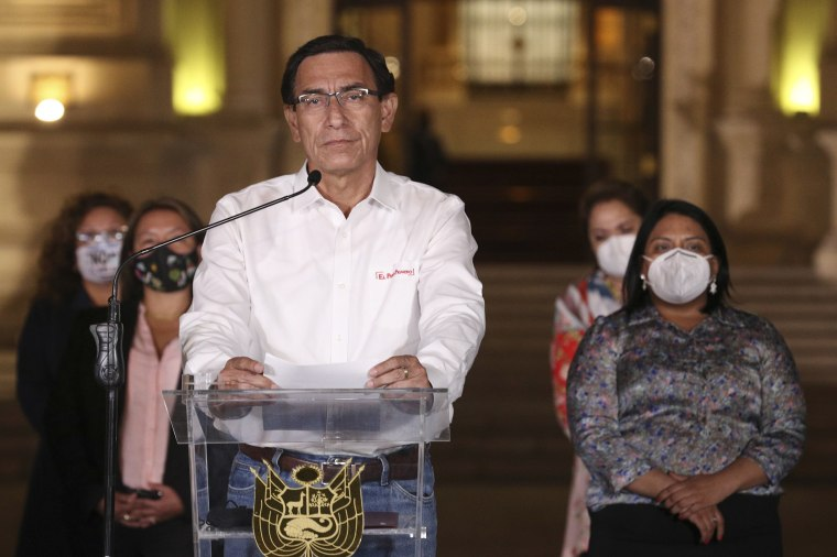 Image: Peru's President Martin Vizcarra speaks in front of the presidential palace after lawmakers voted to remove him from office in Lima, Peru
