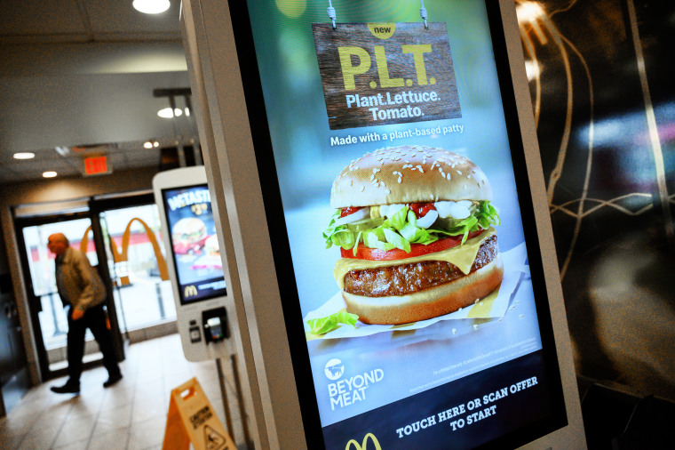 """A sign promoting McDonald's \""""PLT\"""" burger with a Beyond Meat plant-based patty at one of 28 test restaurant locations in London, Ontario"""