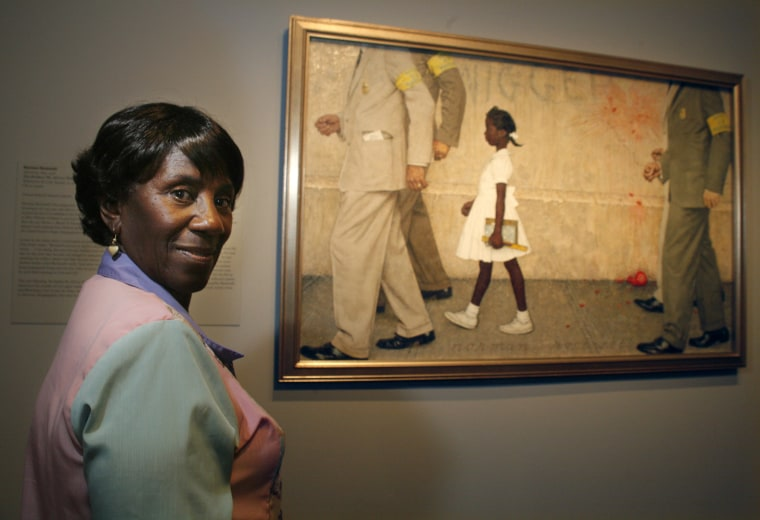 "Image: Lucille Bridges looking at the original 1964 Norman Rockwell painting showing her daughter Ruby, ""The Problem We All Live With,"" inside the Museum of Fine Arts in Houston."