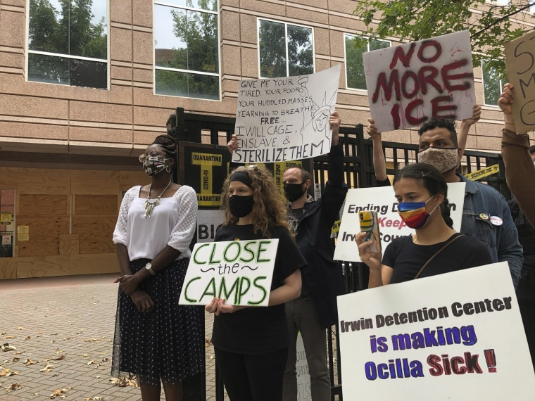 Image: Dawn Wooten, left, a nurse at Irwin County Detention Center in Ocilla, Georgia, speaks at a news conference in Atlanta protesting conditions at the immigration jail