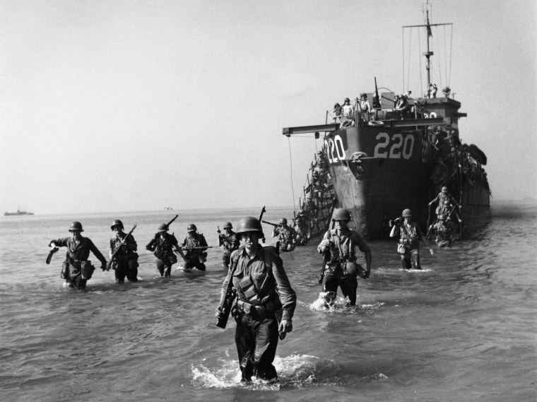 Image: American troops wading ashore from a landing craft during the World War II Allied invasion of Salerno, Italy