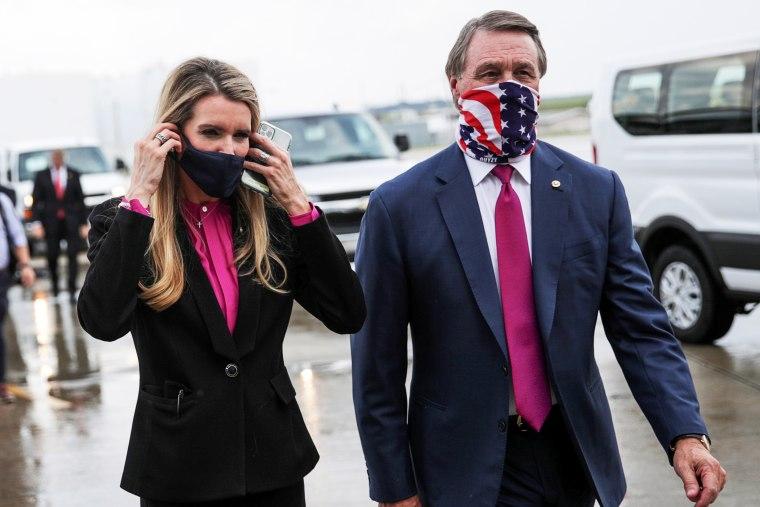 Image: FILE PHOTO: Republican U.S. Senators from Georgia Loeffler and Perdue walk together at Hartsfield-Jackson Atlanta International Airport in Atlanta, Georgia