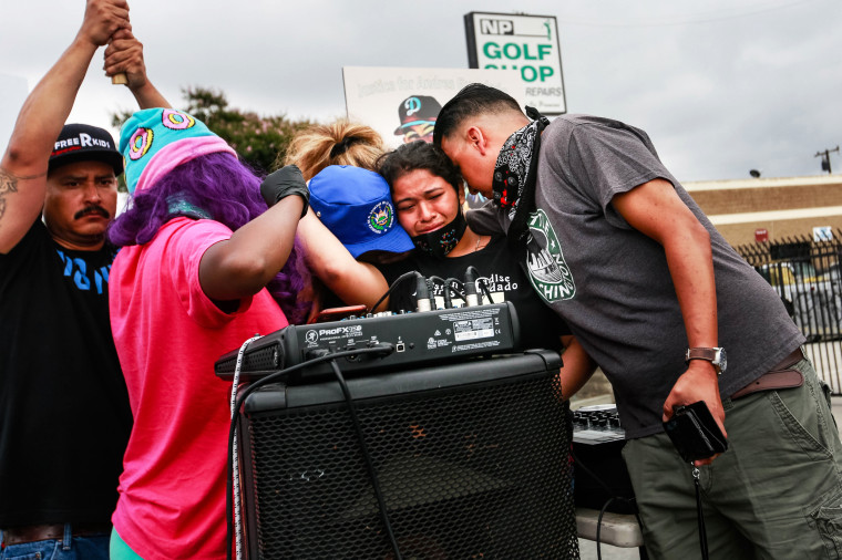 Relatives of Andres Guardado, who was fatally shot by a sheriff's deputy in Gardena, hold a rally