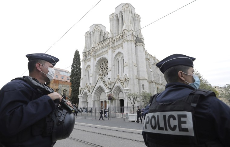 Image: Police officers stand guard near Notre Dame church in Nice, southern France
