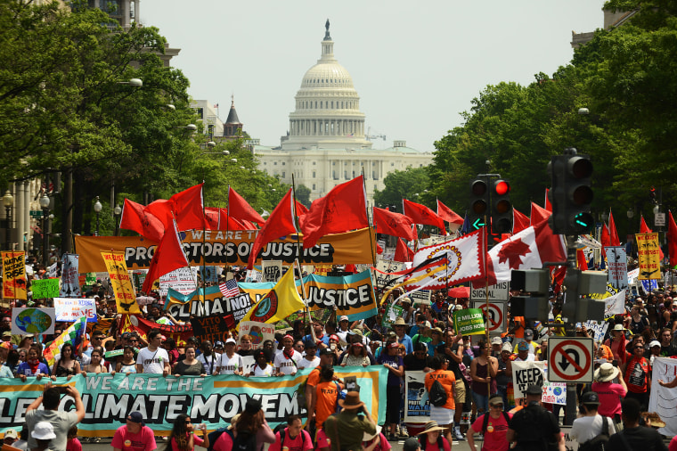 Image: People march from the U.S. Capitol to the White House for the People's Climate Movement to protest President Donald Trump's environmental policies