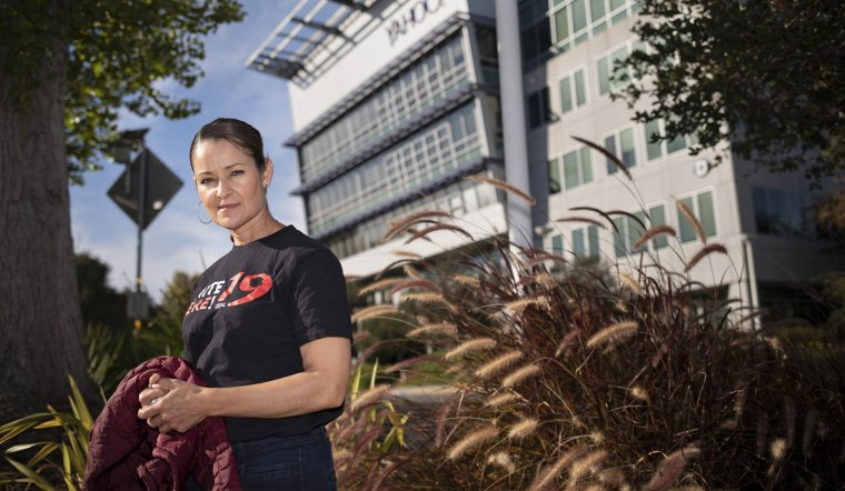 Erika Sanchez stands near one of the buildings in Sunnyvale, Calif., where she worked until she recently lost her job.