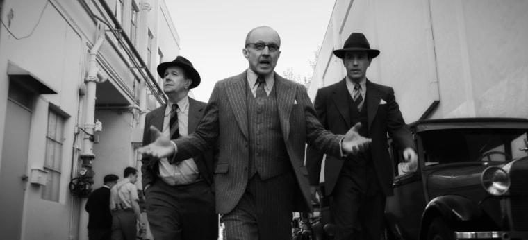 """From left, Gary Oldman as Herman Mankiewicz, Arliss Howard as Louis B. Mayer, and Tom Pelphrey as Joe Mankiewicz in a scene from Netflix's """"Mank."""""""