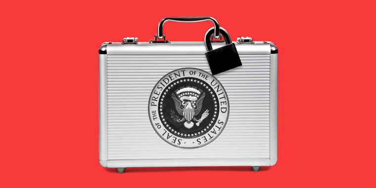 Image: A silver suitcase with a black lock and the seal of the President of the United States sits against a red background