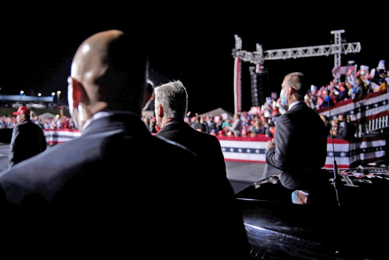 Secret Service members and others listen while President Donald Trump speaks in Hickory, N.C., on Nov.  1, 2020.