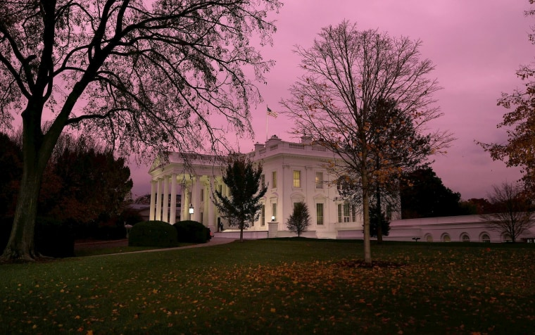Image: Dusk falls over the White House following a rain storm in Washington