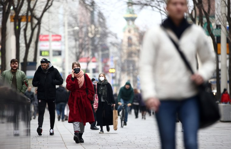 Image: People with protective masks walk down a shopping street during the second lockdown as the coronavirus disease (COVID-19) outbreak continues in Vienna