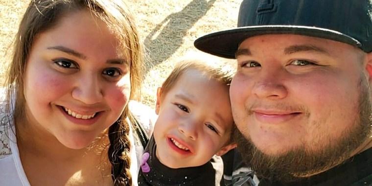 Adan and Mariah Gonzalez hold their son Raiden Gonzalez.