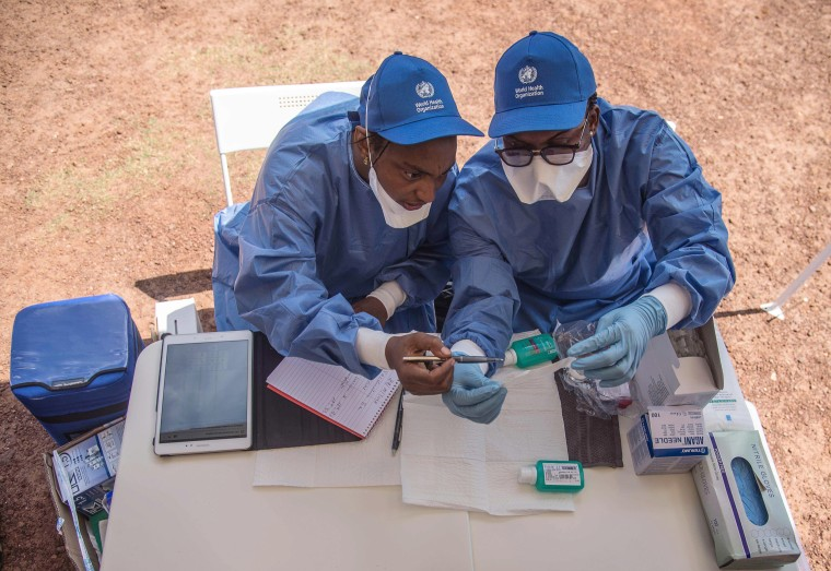 Image: Nurses working with the World Health Organization (WHO) prepare to administer Ebola vaccines