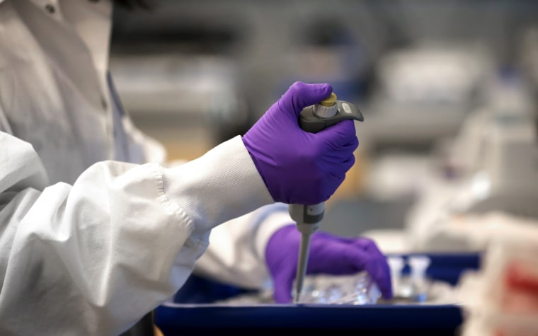 IMage: A scientist works in the Moderna lab in Cambridge, Mass., on Feb 28, 2020.