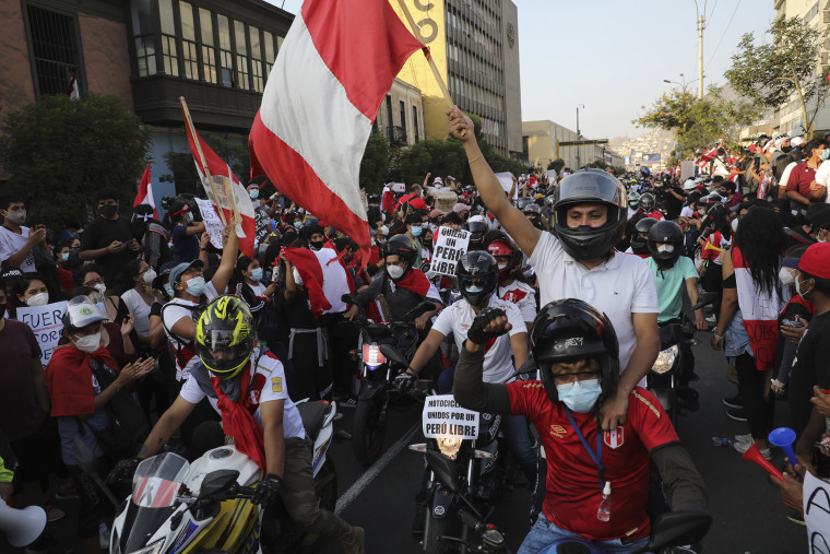 Image: A caravan of demonstrators on motorcycles ride after interim President Manuel Merino resigned his post, in Lima, Peru
