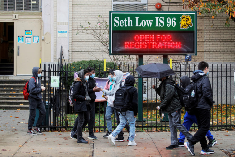 Students exit a school as the spread of coronavirus disease (COVID-19) continues, in Brooklyn, New York